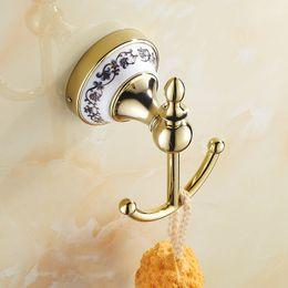 Wholesale golden bathroom accessories - Coat Hooks Anti-corrosion Zinc Alloy Bathroom Accessories Clothes Hooks 2 Hooks Golden Finish Ceramic Holder Wall Mounted
