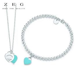 2019 pendentif ovale plaqué or en gros ZEG Haute Qualité Originale Perle Ronde Bleu Amour Bijoux S A Logo Femmes Bijoux Courrier Gratuit