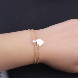 Cuori doppio in metallo online-Braccialetti con ciondoli a forma di cuore con doppia perla e perle in argento dorato metallo bianco perline per donna regalo per donna 2019
