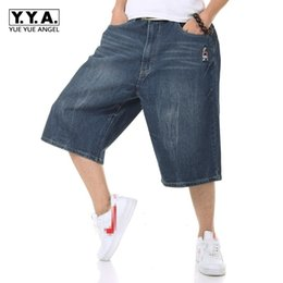 Wholesale mens flare jeans - 2018 New Ripped Flare Pants Mens Jeans Loose Fit Denim Pants Male Casual Hot Sale Plus Size 30-46 Calf Length