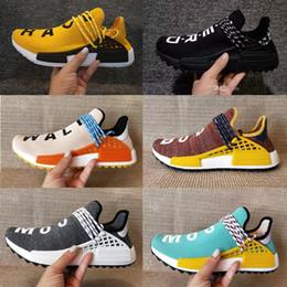 e163e3c4c836d 2018 Adidas yeezy NMD BOOST Creme Homecoming x NERD Solar PacK Corrida Humana  Tênis de Corrida pharrell williams Hu formadores de trilha Homens Mulheres  ...