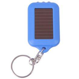 solarbetriebenes geführtes keychain Rabatt Solar Lampen Solarbetriebene LED Taschenlampe Keychain Handlich Ordentlich Helle Kleine Schwarze Solarbetriebene LED Taschenlampe Heißer Verkauf Freies Verschiffen