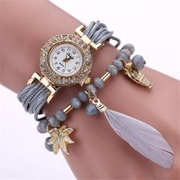 Envolver alrededor de las mujeres relojes online-Reloj de cadena de moda Feather Weave Wrap Around Reloj de pulsera Crystal Sintético Relojes mujeres marca de lujo M.23