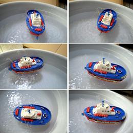 bateaux électriques pour les enfants Promotion L'eau électrique pulvérisant le bateau joue le modèle marin de bateau de délivrance de dessin animé de l'eau de dessin animé pour des enfants d'enfants