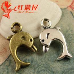 A3925 9 * 27 MM de bronce antiguo metal delfín colgante hecho a mano, joyería de bricolaje al por mayor de plata tibetana animal encantos náuticos para pulsera desde fabricantes