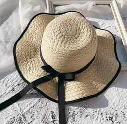 d085093aa324b Versión coreana de verano de la mujer del visor salvaje vacaciones en la playa  sombrero de paja protector solar playa sombrero sombrero para el sol