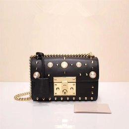 Wholesale Metallic Pearl - Hot sell pearl chain girl bag, oblique cross - female bag, single - shoulder bag, pearl rivet, beauty to no boundary.