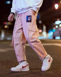 Rosa calças homens on-line-Homens Corredores Hip Hop Harem Calças De Suor Masculina Fitas Carta Bordado Calças Casuais Popular Calças De Carga-de-rosa