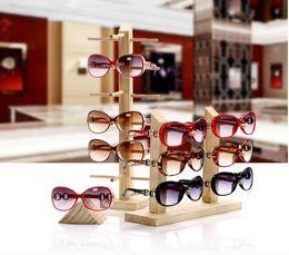 Mostra New Sun degli occhiali di vetro di legno Stand mensola di vetro dell'esposizione Visualizza supporto del basamento Occhiali da Sole Occhiali Rack Nove formati può scegliere da lenti 43mm fornitori