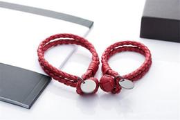 braccialetti a forma di oro Sconti Braccialetti di cuoio intrecciati di marca Italia Braccialetti di polsino unisex di lusso Braccialetto d'argento di titanio di lusso che appende il regalo dell'amante del braccialetto