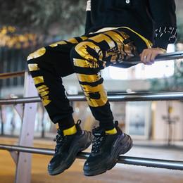 Nuevo Hombre Streetwear Hip Hop Pantalones Casuales Pantalones de chándal  sueltos Joggers de moda Pantalones de chándal Hombres Oro Impreso Pantalones  Harem 1d3ee4ab5e5