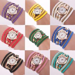 Moda colorida de la vendimia relojes Weave Wrap Rivet señoras pulsera de cuero relojes de pulsera cadena vestido de relojes para mujer damas desde fabricantes