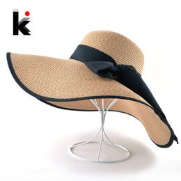 Fashion Straw Hat For Women Summer Casual Wide Brim Sun Cap With Bow-knot  Ladies Vacation Beach Hats Big Visor Floppy Chapeau D18103006 c7c1d74e6835