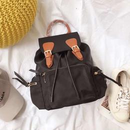 2019 mochilas circulares Mochila de viaje de lona unisex diseñador de moda de lujo famosa marca mujeres mochilas señora bolsos de hombro de calidad superior seis colores venta caliente mochilas circulares baratos