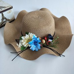6ca9f530991 2018 summer new style big brim hat imitation flower straw hat lady Korean  version of tourism beach shading discount korean straw hats