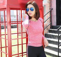 t-shirt in esecuzione libera Sconti Nuova maglietta della manica lunga delle donne 1pcs che mette in mostra l'abbigliamento di allenamento di addestramento della palestra di forma fisica degli abiti sportivi di yoga che spedice liberamente