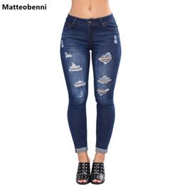 Lejía Lavar rallado rasgada lápiz los pantalones vaqueros flacos de las mujeres azul mediados de cintura de los pantalones largos flacos 2018 Botón Roca elástico Denim Jeans desde fabricantes