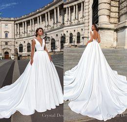 Wholesale Designer Wedding Dresses - 2018 Designer Backless Wedding Dresses Cheap Elegant Deep V Neck Sweep Train Satin Wedding Dress with Beaded Sash Custom Made Bridal Gowns