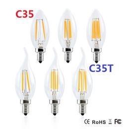 ampoule à fil Promotion Les doubles fils d'or 2W 4W Edison LED ampoules de filament Dimmable E12 E14 E17 ont mené la lampe de lumières de bougie 360 d'angle économiseur d'énergie à CA 110-240V