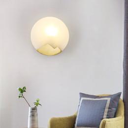 Argentina JESS nueva lámpara de pared de mármol del cuarto de baño de la cabecera del diseñador creativo del fondo del diseñador de la luz de la pared china Suministro