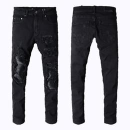 Pantaloni sportivi sottili mens online-Jeans da uomo miri sport da running Jeans da motociclista skinny Sottili strappati Popolari Cool mendicante Vero buco vero pantaloni jeans firmati da uomo