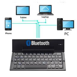2019 складывающаяся клавиатура bluetooth KuWfi Mini Bluetooth Складная Клавиатура 64 Клавиши Алюминиевого Сплава Двухканальная Клавиатура Для Телефона / ПК / Ноутбука / Планшета скидка складывающаяся клавиатура bluetooth