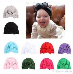 Wholesale head covers beanies - 2017 Fashion Baby Girls Caps Big Bow Hat Europe Style Turban Knot Head Wraps India Hats Ears Cover Kids Children Bohemia Beanie BH79