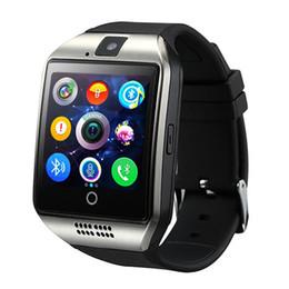 Boxeo para niños online-Q18 reloj inteligente Bluetooth Relojes Reloj de pulsera DZ09 con cámara Ranura para tarjeta SIM TF Podómetro Respuesta llamada con caja para Android IOS iPhone Samsung