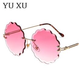 óculos de sol da flor Desconto Yu Xu novo em forma de flor sem moldura de ponta óculos de sol das mulheres marca designer de óculos de sol moda personalidade decorativa rodada óculos de sol H100