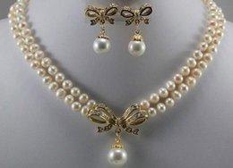 Argentina Juego de aretes colgantes con perlas blancas de 18 quilates de oro amarillo GP 6-7mm supplier 18k yellow gold pearl sets Suministro
