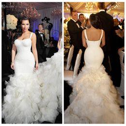 899ebab24688 2018 Spaghetti Sexy Kim Kardashian Slim Mermaid Wedding Dresses Tiered  Skirt Lace Organza Chapel Train Bridal Gown Custom