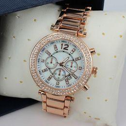 Las mujeres de negocios MK relojes de marca de lujo de moda de acero  calendario de oro rosa reloj de mujer relojes por mayor bcc210788c91
