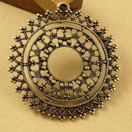 Wholesale wholesale bronze filigree - 40MM Antique Bronze Retro pattern big round filigree pendant charm jewelry making accessories, DIY metal pendants for friends