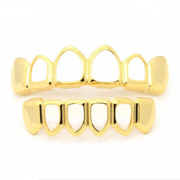 grill cap Promo Codes - Hip Hop Teeth Grillz Hollow Top &Bottom Fangs Bottom Grillz Set Vampire Grills Sets Gold Bling Hollow Bloodsucker Tooth Caps