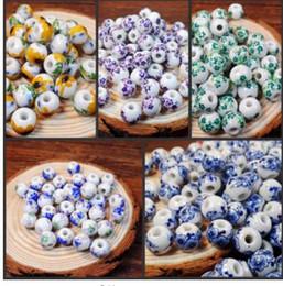 Faça porcelana on-line-XINYAO 50 pçs / lote 10mm Grande Grande Buraco Grânulos De Cerâmica Flor Azul E Branco Porcelana Contas Artesanais DIY Jóias Fazendo Acessórios