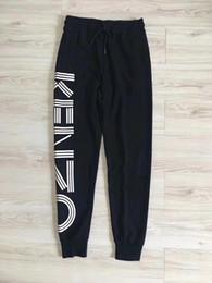 Pantaloni lunghi sudore pantaloni online-2019 Pantaloni da jogger da uomo firmati Pantaloni da jogger di marca di alta qualità Pantaloni con coulisse a righe laterali Pantaloni sportivi da uomo di marca