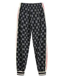 Europa y los Estados Unidos otoño nuevos hombres y mujeres pantalones impresión del cuerpo moda casual suelta pareja haz pantalones desde fabricantes