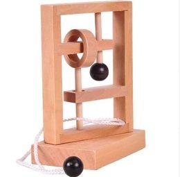 Juego de cuerdas online-Rompecabezas de madera clásico Teaser String Topology Juego Toy Tridimensional Space Solution Cuerda de juguete para niños Caja de regalo