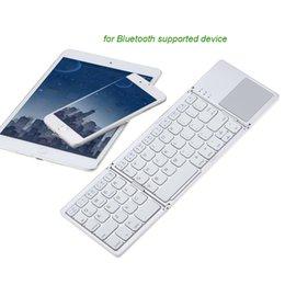 Wholesale Slim Mini Wireless Bluetooth Keyboard - KKmoon Portable Mini Ultra Slim Thin Foldable Folding Bluetooth Wireless Keyboard with Touchpad for iPhone 6s iPad Pro MacBook Mobile Phone
