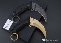 Um karambit aus on-line-New karambit garra o Doom javali AUS-8 G10 caça acampamento facas de sobrevivência faca de presente de Natal 1 pcs amostra freeshipping