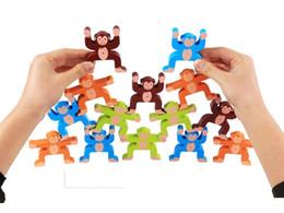 Укладка игры онлайн-Обезьяна сбалансированные строительные блоки игры сложены высокие деревянные игрушки детская рука координация глаз и баланс обучение учебные пособия