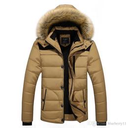 Uomini giacche invernali cappotti nero caldo piumino esterno con cappuccio di pelliccia mens di spessore faux fur interno parka più taglia marca famosa L-4XL da