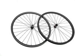 Ruedas de 35mm online-Juego de ruedas de MTB de carbono 29er Juego de ruedas de carbono de montaña de 12K 35mm con vacío de un barril