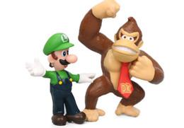 Muñeca goomba online-18 unids set Super Mario Bros Figuras de acción Juguetes conjunto Yoshi Dinosaur Peach Toad Goomba PVC Doll Mario Luigi PVC juguetes regalos envío gratis