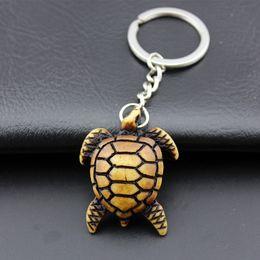 Wholesale 12PCS Cool Men Women s Car Keychains Imitation Yak Bone Carved Tortoise  Key Chains Sea Turtles Keyrings for Children s Gift KR06 d3629ee3c3