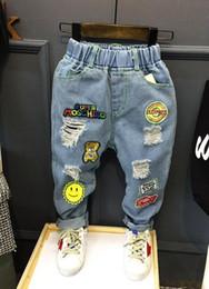 71782db11c2f7 Enfants Broken Hole Pants Pantalons Bébé Garçons Filles Jeans Marque De Mode  Automne 2-6 ans Enfants Pantalon Vêtements Enfants (AQ878