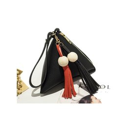 hand bags new types Coupons - Women triangle tweezers type clutches bag 2018 autumn and winter new lychee wood ball tassel hand take purse