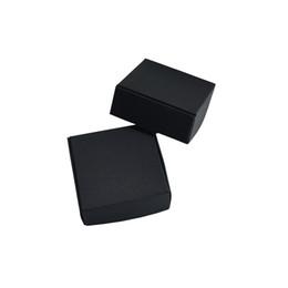Paquet de carton en Ligne-50pcs / lot 5.5 * 5.5 * 2.5cm Boîte de rangement cadeau de papier d'artisanat noir Bijoux Décoration de fête Petit Carton Biscuits de Bonbons Épicerie Emballage Paquet Boîte