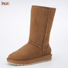 eeb7295fbac Clásico de alta calidad de las mujeres de invierno botas de nieve de piel  de oveja piel forrada zapatos de invierno negro marrón rojo antideslizante  único ...