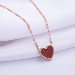 Collana a forma di cuore in oro rosa con gemme bianche e rosse a forma di cuore in oro rosa cheap young necklace da giovane collana fornitori